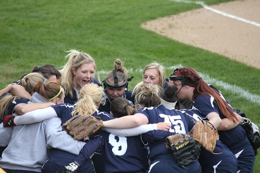 The Varsity Softball Team  huddles together before their game against Wayne, where the Firebirds went on to win 5-4.