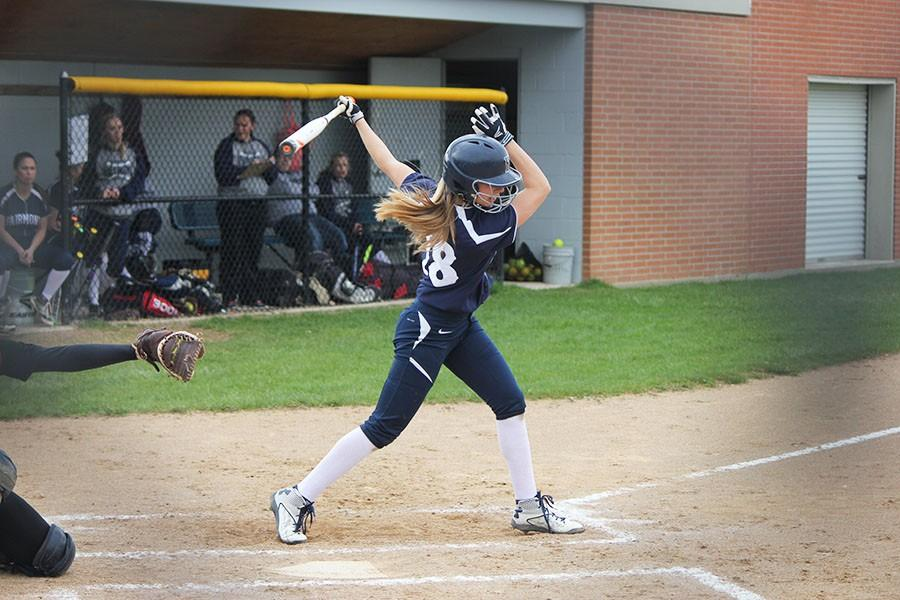 Becca Johnson swings while up to bat.