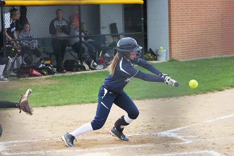 Bri West bunts the ball in hopes of getting her teammates around the bases.