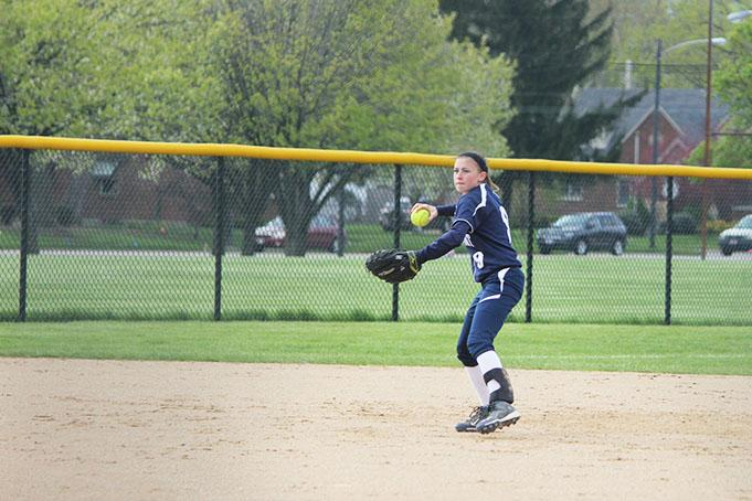 Shortstop Bri West prepares to throw to first base after stopping the ground ball.