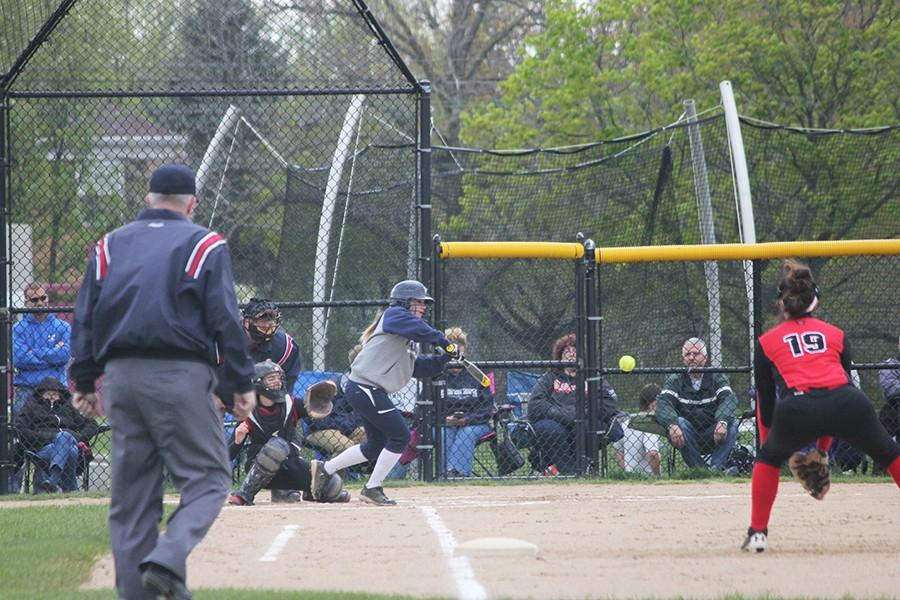 Taylor Baer swings and hits the ball.