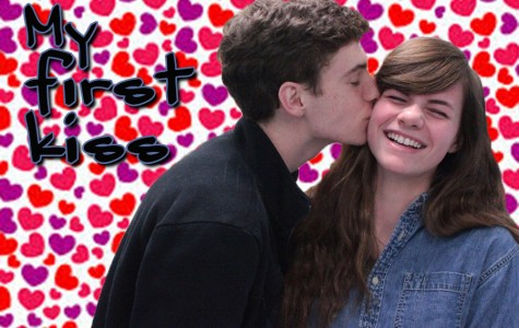 Junior Jamie Cunningham gives a peck on the cheek to his girlfriend, Lindsay Breslin.