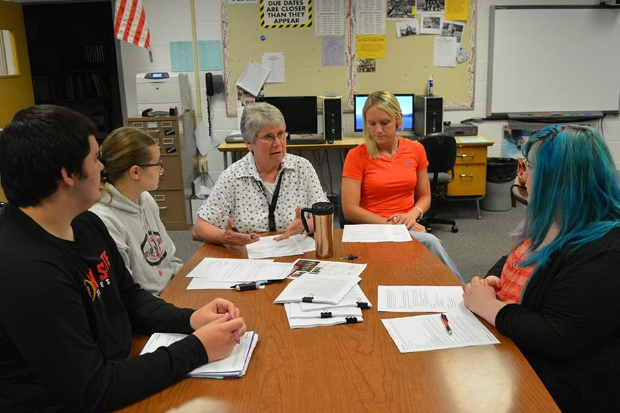Retiring Flyer Adviser Janie Ross and new Adviser Lacy Romine plan for the transition with Editor-in-Chief Dalton Smith, Chief Photographer Emily Latham and Editor-in-Chief Brittany Peckham during the last week of school. Romine was on