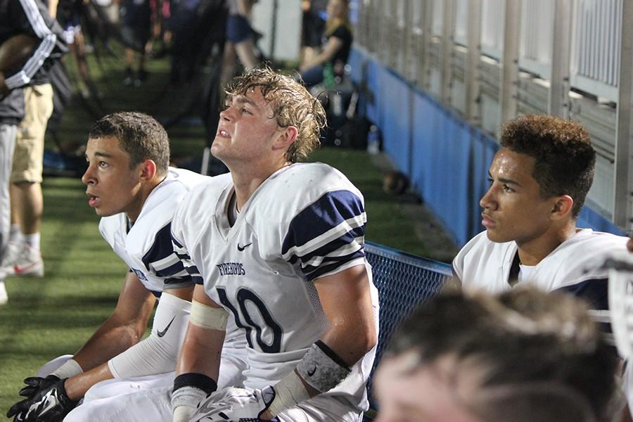 Juniors Camren Crayton and Trevor Cukovecki, along with sophomore Camron Kirkpatrick resting as the Fairmont offense takes the field.