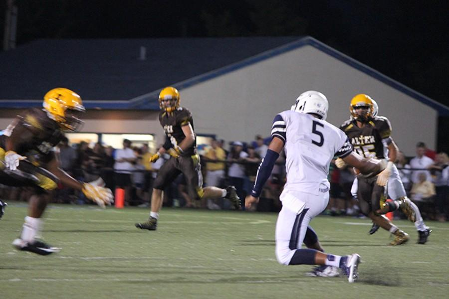 Senior Corde Kyles cutting hard, faking out the Alter defense.
