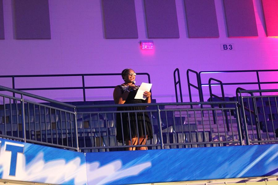 Senior Whysper Applin announces the name of the Homecoming courts.