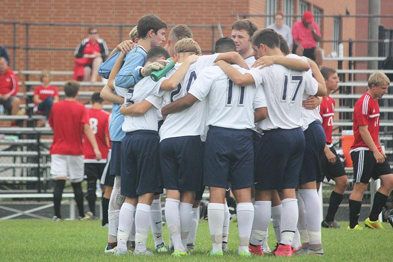 The team huddles up before the game starts