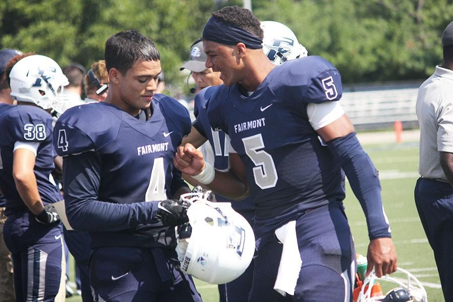 Fairmont quarterback, Corde Kyles, discusses strategies to wide receiver, Max Britt.