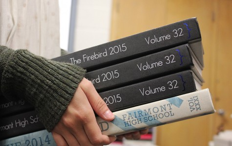 Junior Yearbook Business and Marketing Manager, Madison McKay-Bradds, holds this years and last years yearbook comparing the two.