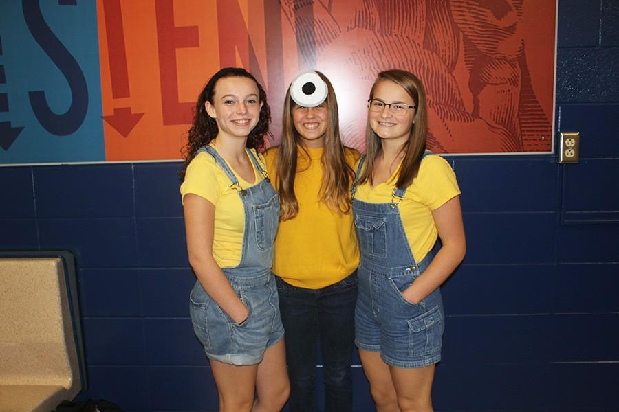 (L-R) Allie Tincher, Kassie Strahler, and Abby Watson posing for Minion Day.