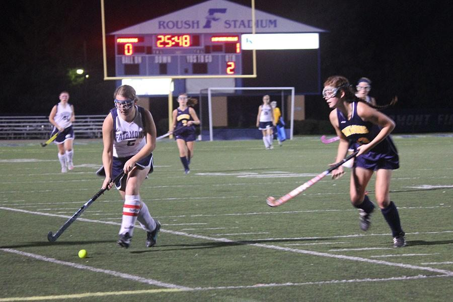 Senior Captain Gillian Garland quickly brings the ball up the field.
