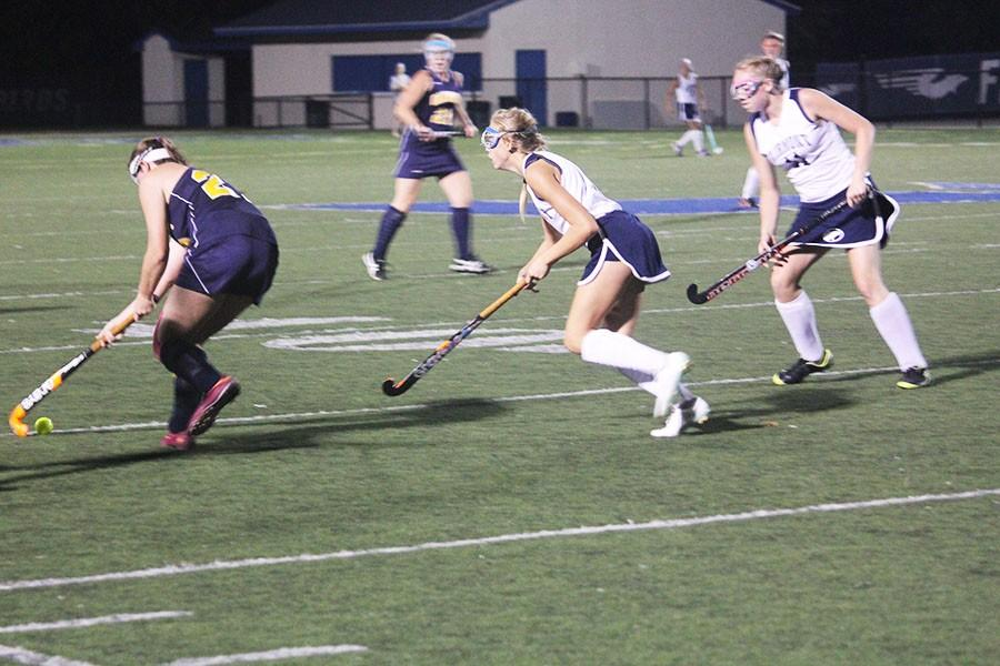 Sophomore Hailey Spitler and senior Katie Swiger  work together to get possession of the ball.