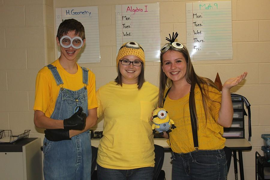 From left to right, (name), Mrs. Brewer, and (name) pose for Minion Day.