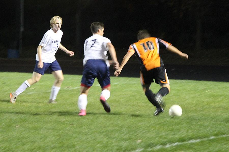 Sophomore, Caden Danner, and Junior, Ben Kelley, trying to steal the ball from Beavercreek offender.