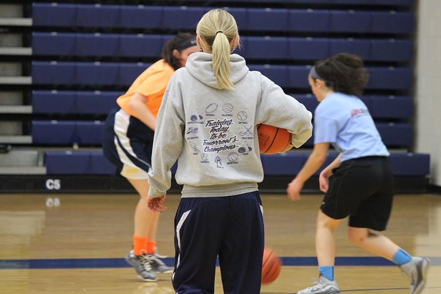 Firebird Head Coach, Lacy Drake, watches as her team runs drills at tryouts.