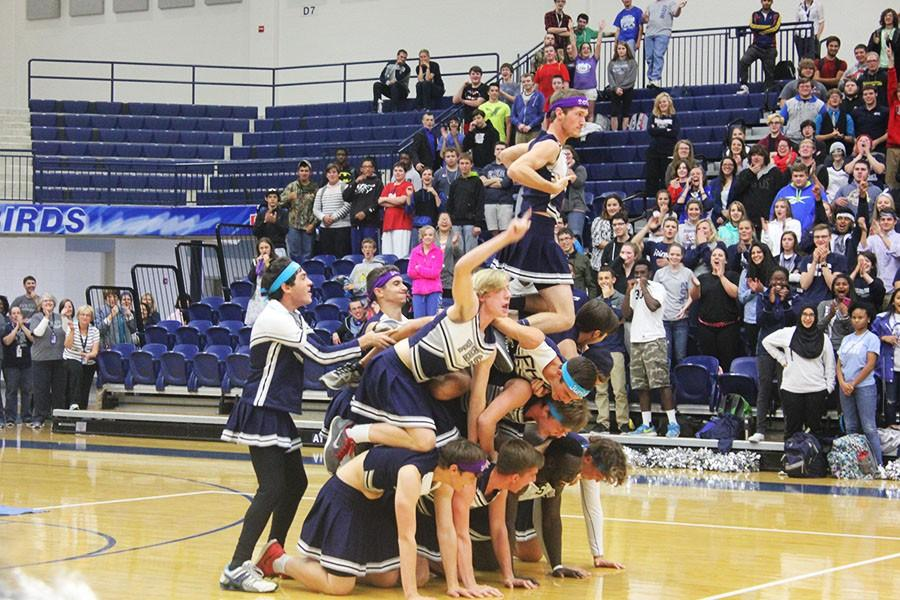 Fairmont's Powderpuff cheerleaders do a mount in their dance off against the girl cheerleaders at the annual Pep Rally.