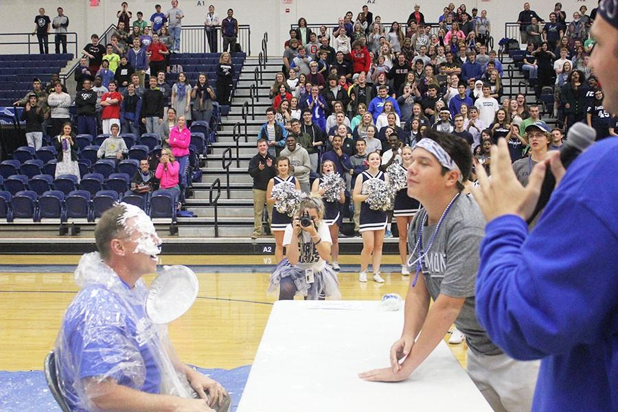 Fairmont junior Keiran Davis pies Andrew White, the Central Unit principal.