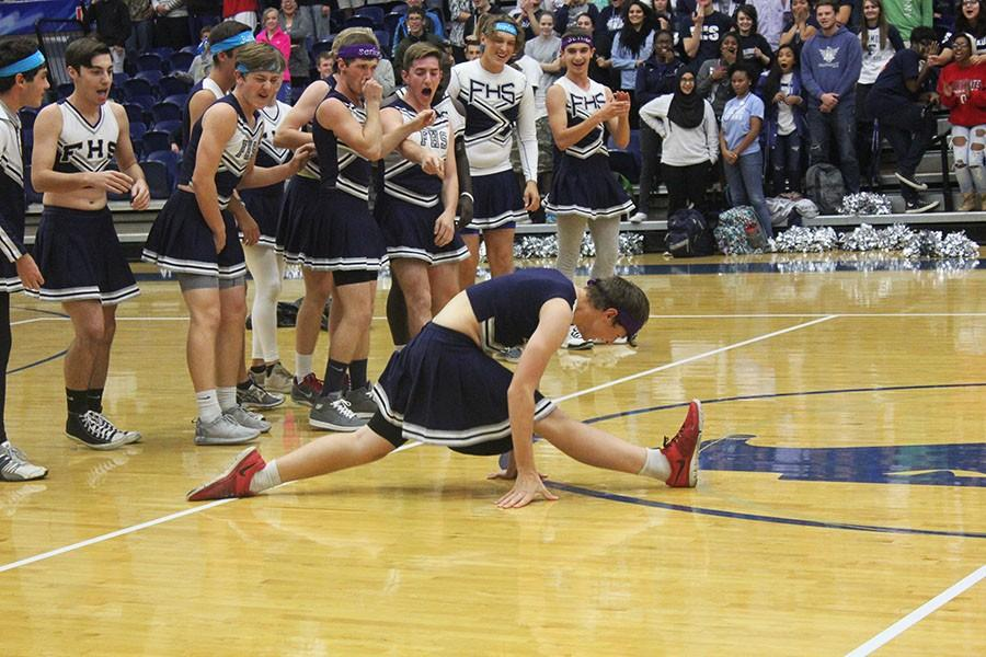 Fairmont senior Holden Duncan wows the crowd at the annual Spirit Chain pep rally by doing the splits.