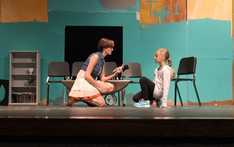 Senior Maddie Schroll and 10-year-old lead Lucy Bruzzese rehearse part of the play, The Bad Seed.