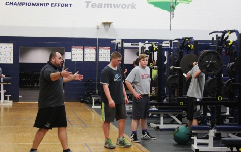 Coach Swain instructs his student-athletes at the beginning of an after school workout session.