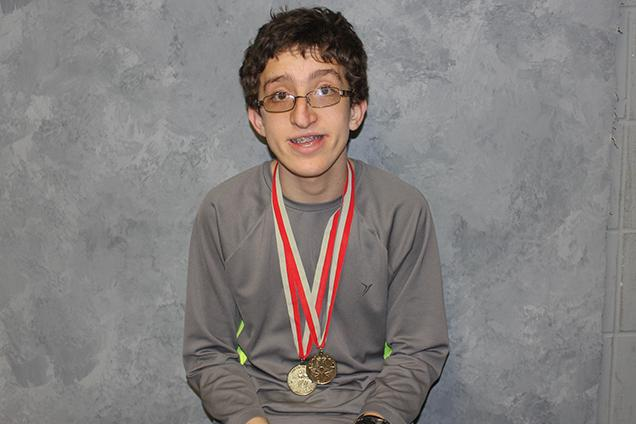 Fairmont Student-Athlete Theodore Hale wears his Special Olympics medals proudly.