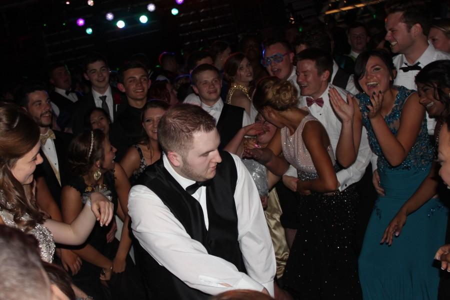 Senior, Ryan Yoxtheimer, showing off his moves as his friends cheer him on.