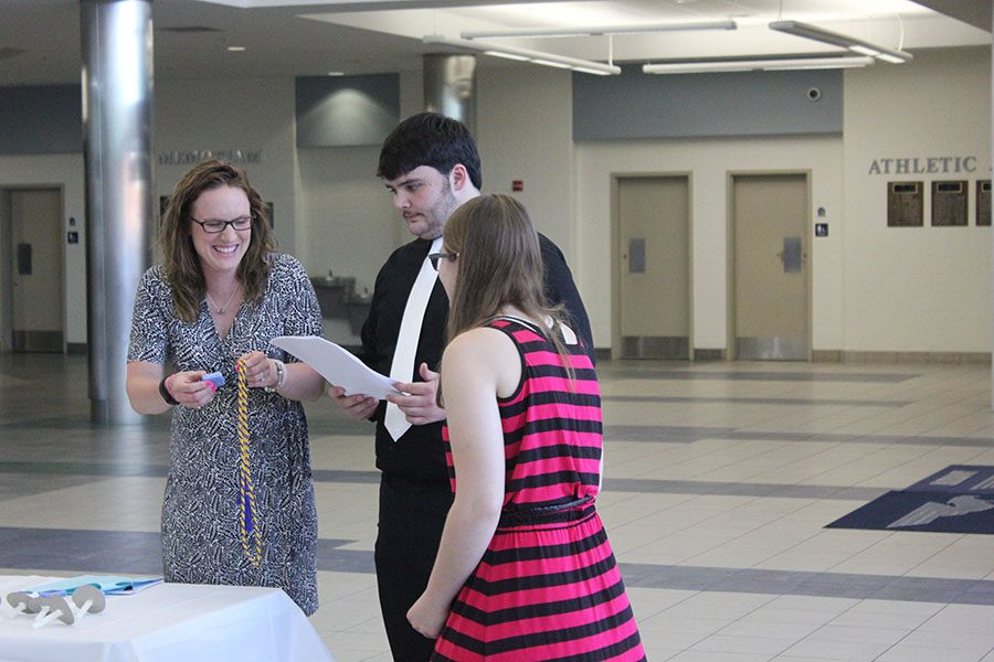 Emily Latham, Dalton Smith and Lacy Drake lead the group in the formal Quill and Scroll ceremony.