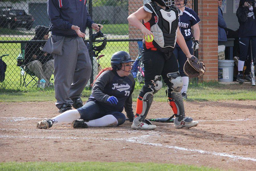 Senior Melanie Grant  slid into home to score another point for the Firebirds.