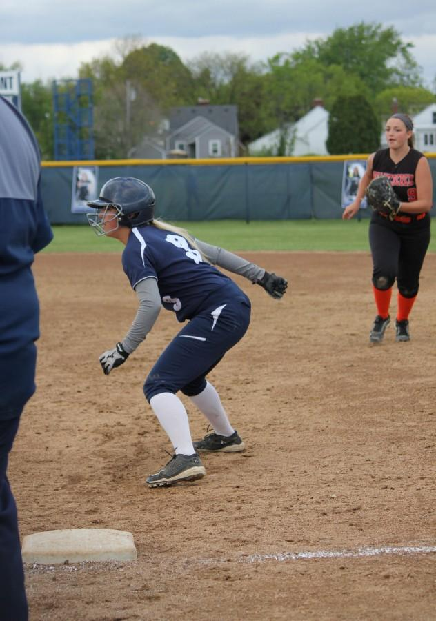 Senior Taylor Baer goes to steal second base.