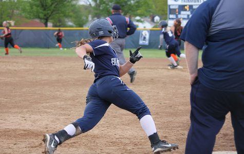 Senior Kierah Parker rounds first heading to second.