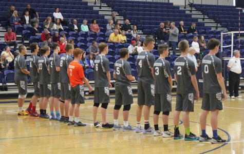 The Fairmont varsity boys volleyball team lines up for the national anthem right before the game begins with Centerville.