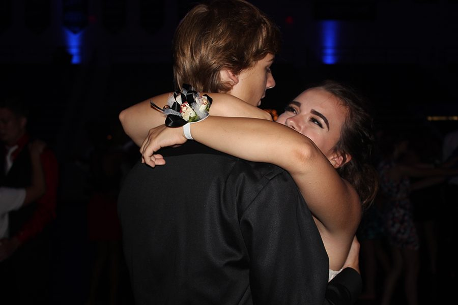 Haley Glascoe and Jake Berry enjoy a slow dance in The Trent Arena at the Firebirds homecoming dance.