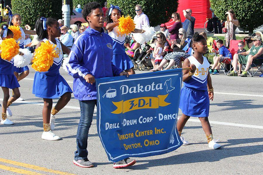 The Dakota Cheer, Drum Corp, and Dance team marching through the parade.