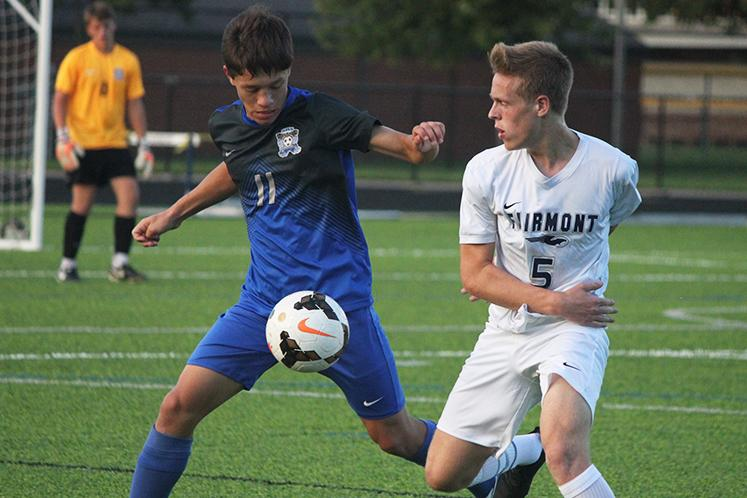 Jack Bishop rushes to the ball in front of Springboro opponent.