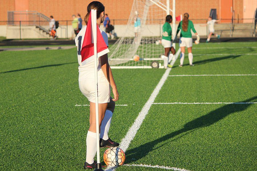 Junior Lexie Aukerman warms up her corner kick before the game.