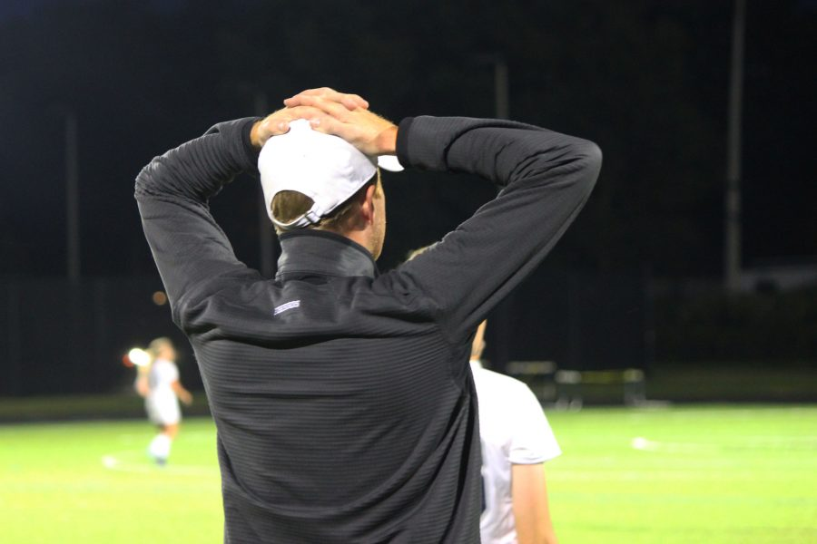 Coach Reade Faulkner stresses about the score of the second half.