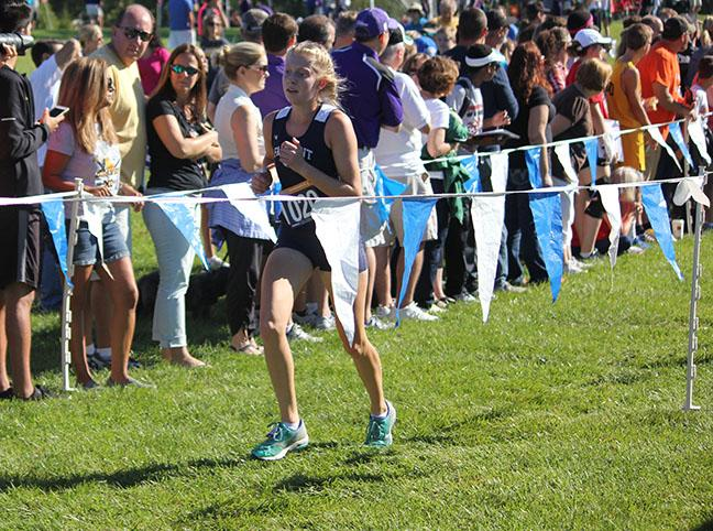 Sophomore, Cara Cannarozzi, sprints the home stretch to finish the race.
