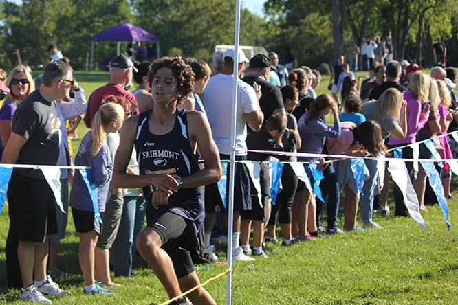 Sophomore, Ellis Blanco, finishing the race with a competitive end.