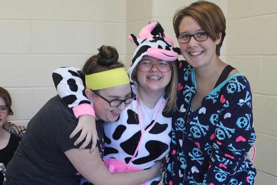 Students dress in various onesies for PJ day