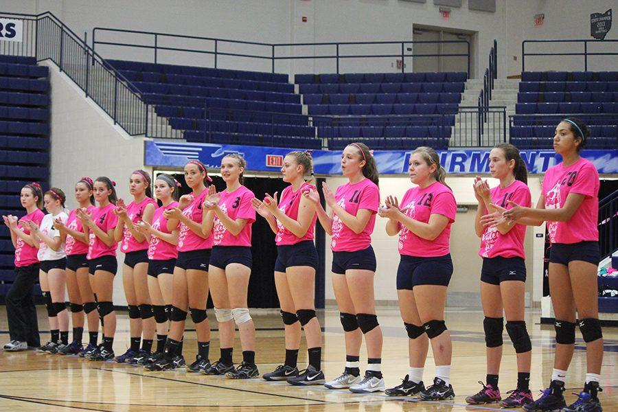The+girls+volleyball+team+represents+their+support+for+breast+cancer.