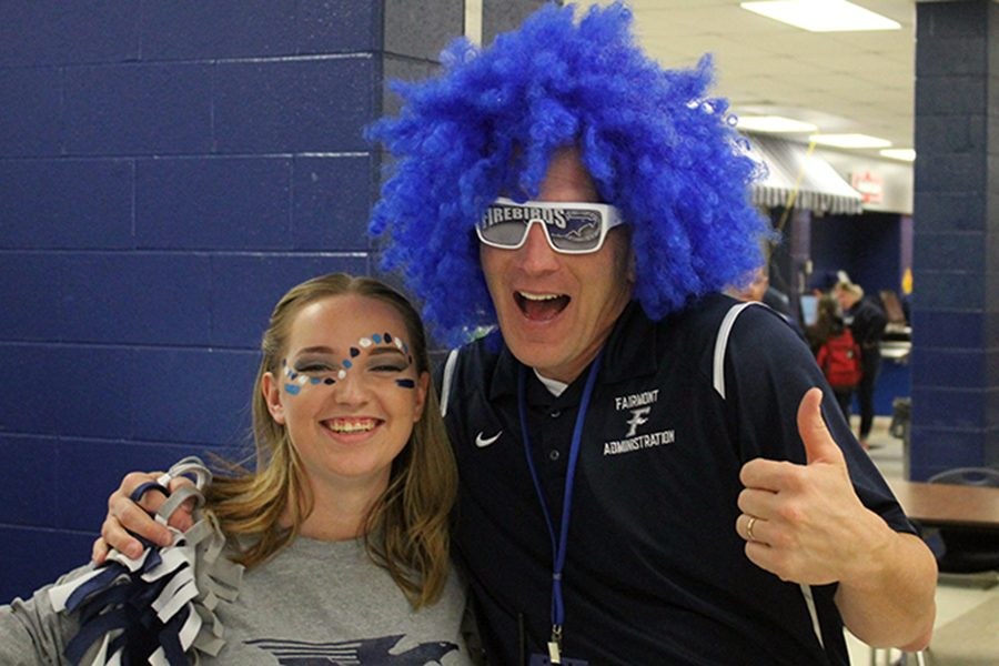 Senior, Kayla Brightwell and South unit principal Jeff Renshaw go over the top for spirit day.
