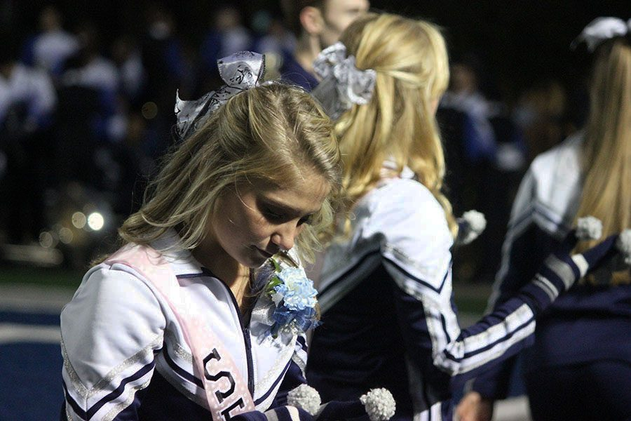 Varsity cheerleader, Lauryn Houseman, thinks upon her last time cheering at Roush Stadium.