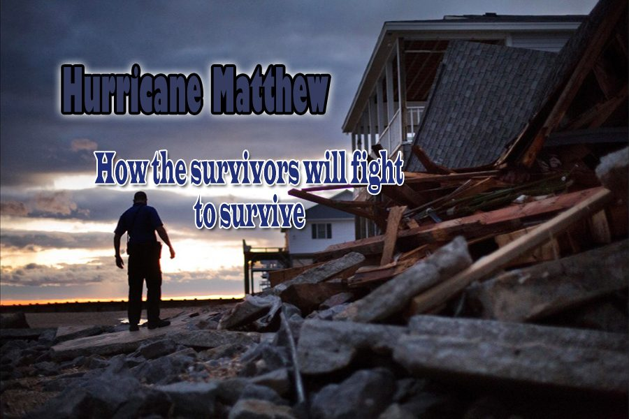 Hurricane+Matthew+survivor+walks+along+the+wreckage+of+what+was+once+his+home.