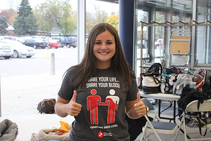 Junior, Abigail Snodgrass, giving a thumbs up to donating blood.