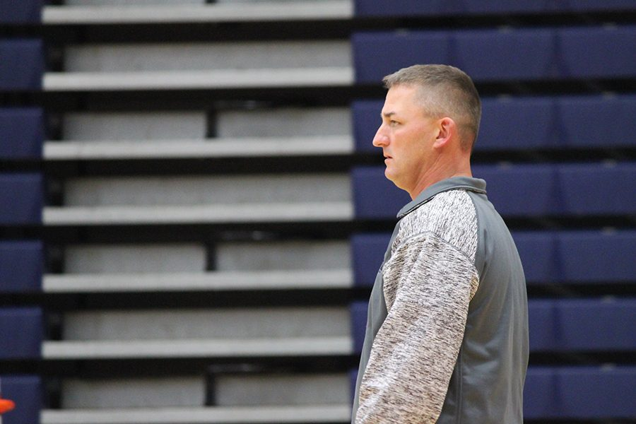 Coach Joshua Jackson watches his 7th grade Navy team on the court.