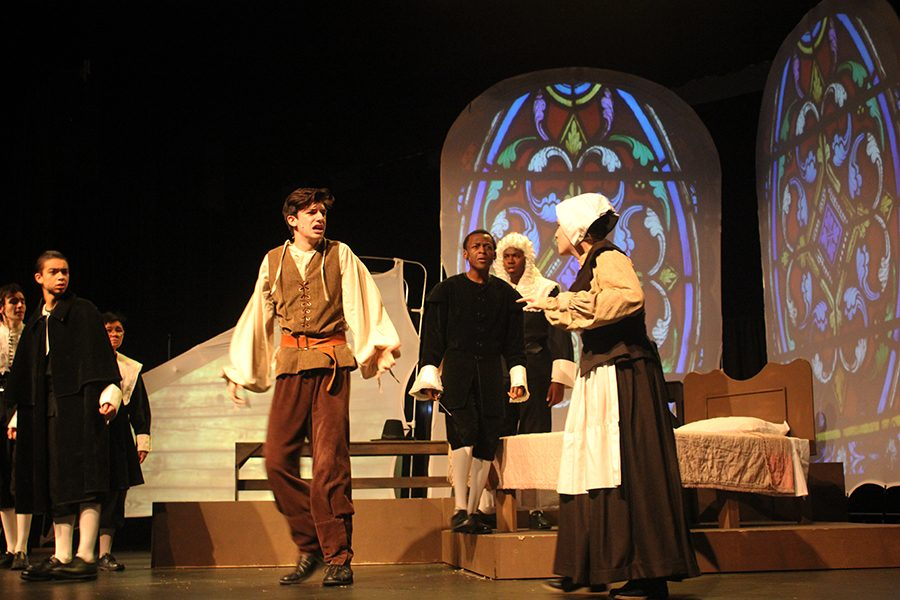 The cast of The Crucible acting out a scene during their final dress rehearsal.