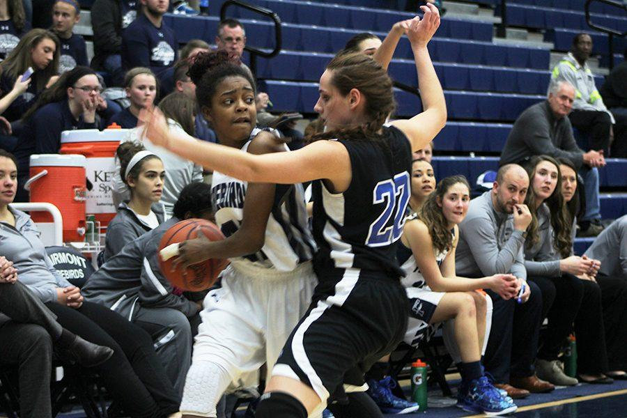 Freshman%2C+Makira+Webster%2C+toughly+defended+while+looking+for+an+open+pass.+
