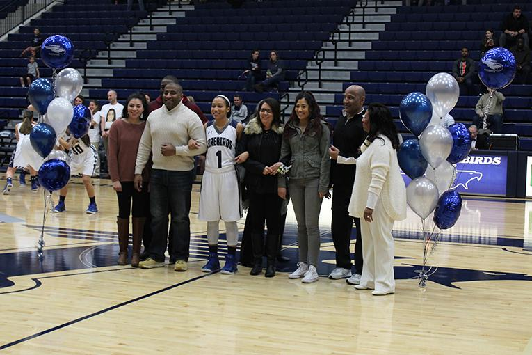 Senior%2C+Mariah+Roe%2C+being+congratulated+on+her+last+highschool+home+game.+