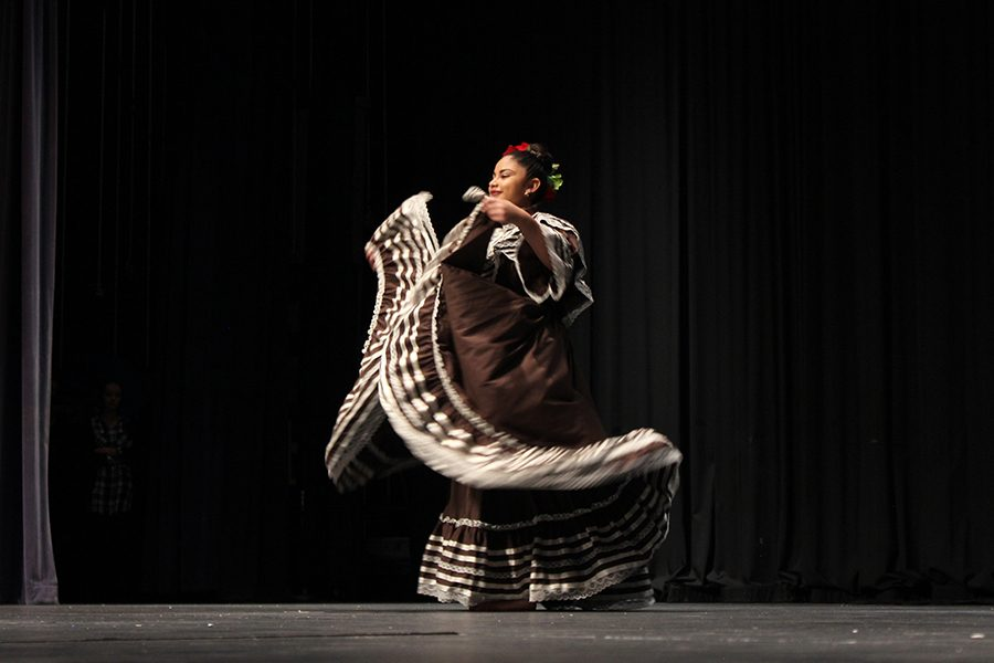 Senior,  Maria Imelda Frias, uses her dress as a tool in her traditional dance.