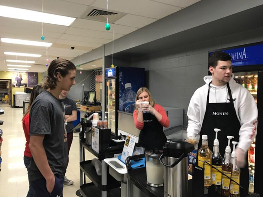 Members of The Flyer staff test  out the coffee and lattes at Fairmont's new coffee bar a day before the grand opening.